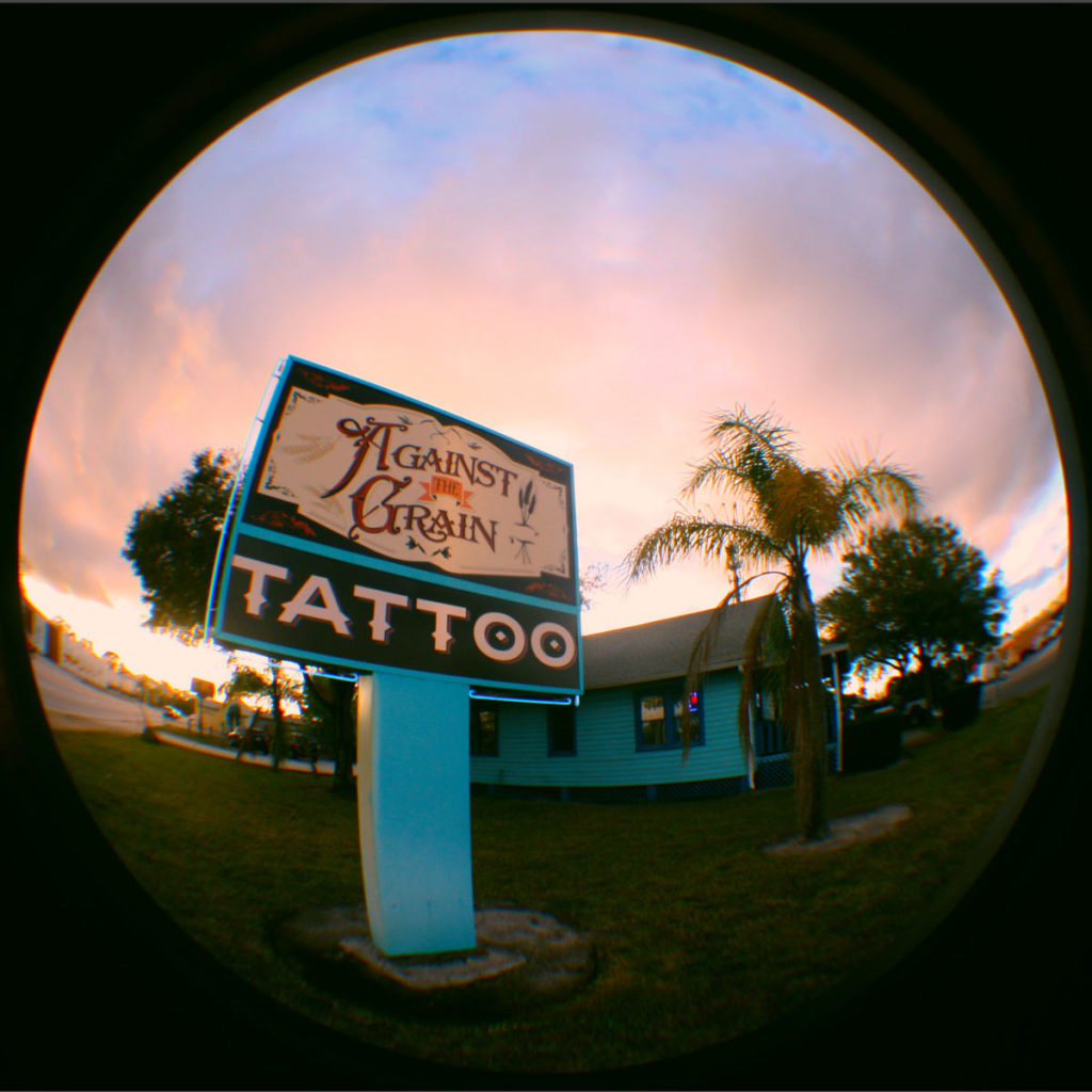 Against-the-Grain-Tattoo-Pinhole-Cam-Outside-the-Shop